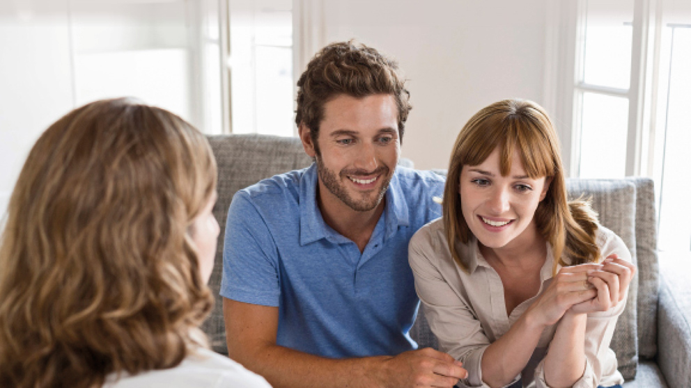 Couple getting advice from their Financial Adviser